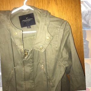 Green zip up jacket